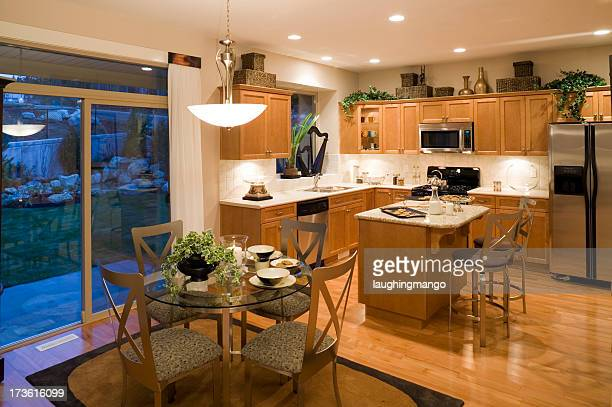 Brightly lit kitchen and dining room with birch cabinets