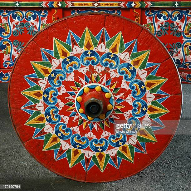 Brightly painted coffee cart wheel