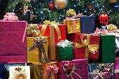 Xmas presents stacked under tree