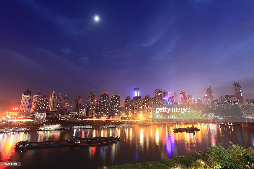 Brightly-lit buildings along the river in Chongqing