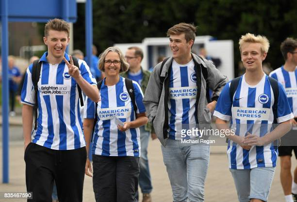 Brighton and Hove Albion fans arrive in good spirits prior to the Premier League match between Leicester City and Brighton and Hove Albion at The...