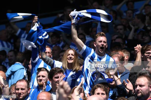 Brighton and Hove Albion fans celebrate after their side scores their first goal during the Sky Bet Championship match between Aston Villa and...