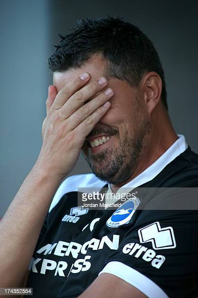 Brighton and Hove Albion manager Oscar Garcia reacts ahead of the preseason friendly against Crawley Town FC at Broadfield Stadium on July 24 2013 in...