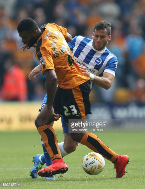 Brighton and Hove Albion's Tomer Hemed and Wolverhampton Wanderers' Ethan EbanksLandell battle for the ball