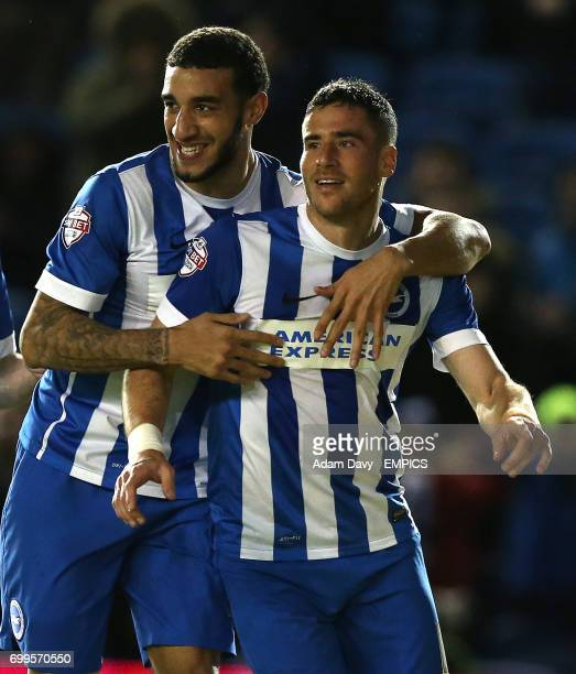 Brighton and Hove Albion's Tomer Hemed celebrates scoring the second goal with team mate Connor Goldson