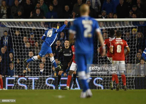 Brighton and Hove Albion's Tomer Hemed heads towards goal bringing a great save from Charlton Athletic goalkeeper Stephen Henderson but the ball...