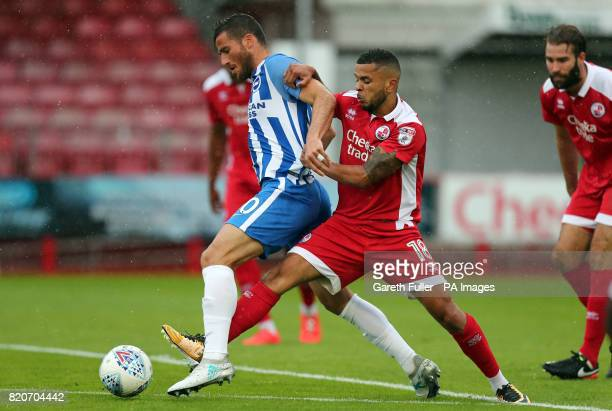 Brighton and Hove Albion's Tomer Hemed is challenged by Crawley's Billy Clifford during the preseason friendly match at Checkatradecom Stadium Crawley