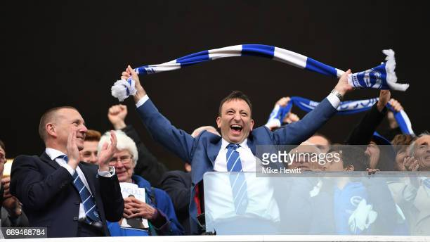 Brighton CEO Paul Barber watches Chairman Tony Bloom celelebrate at the end of the Sky Bet Championship match between Brighton Hove Albion and Wigan...