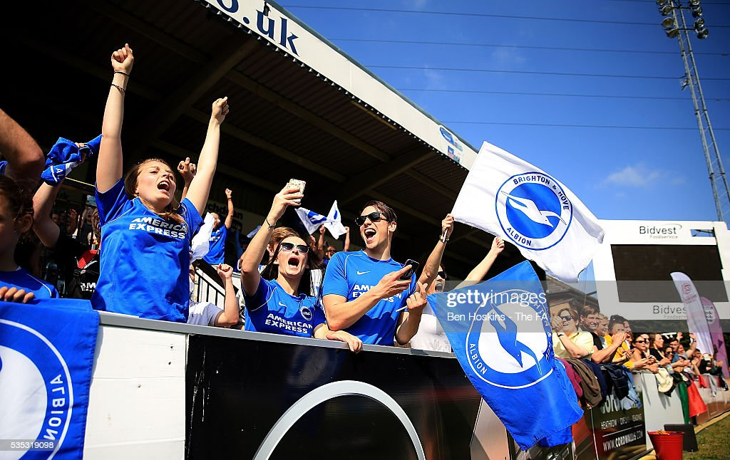 Brighton fans celebrate their team's victory in the WPL Playoff match between Brighton & Hove Albion WFC and Sporting Club Albion LFC at Adams Park on May 29, 2016 in High Wycombe, England.