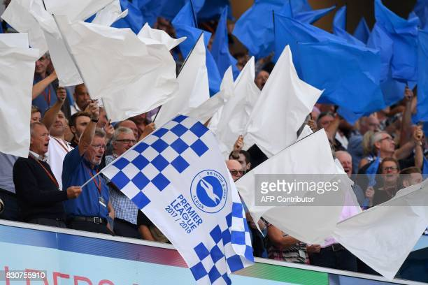 Brighton fans wave flags in the crowd before kickoff in the English Premier League football match between Brighton and Hove Albion and Manchester...