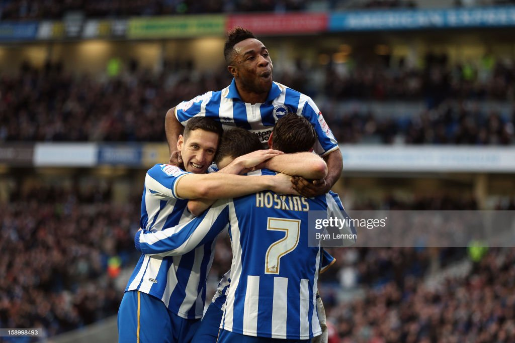 Brighton Hove Albion celebrate with Will Hoskins after scoring during the FA Cup with Budweiser Third Round match between Brighton Hove Albion and...