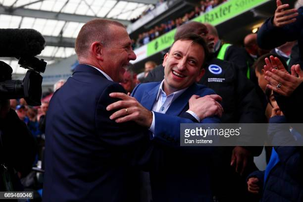 Brighton Hove Albion CEO Paul Barber and Chairman Tony Bloom celebrate with the players in the stands after victory in the Sky Bet Championship match...