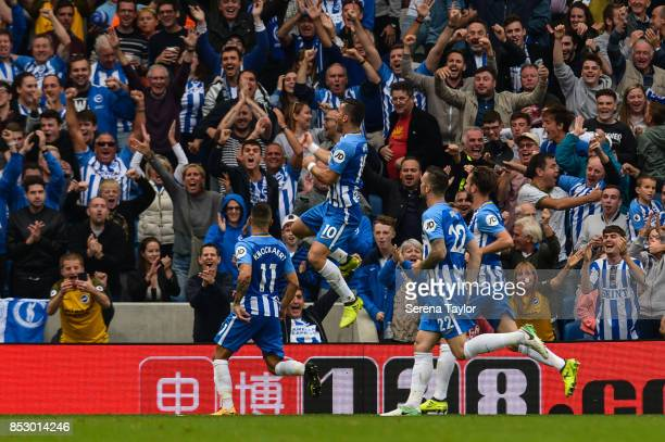 Brighton Hove Albion Forward Tom Hemed celebrates with teammates after he scores the opening goal during the Premier League match between Brighton...