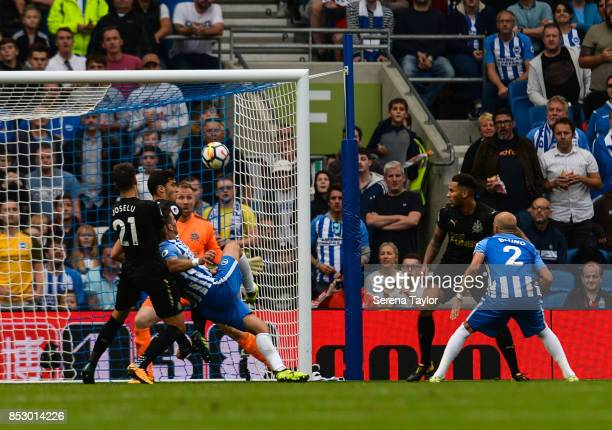Brighton Hove Albion Forward Tom Hemed scores the opening goal during the Premier League match between Brighton and Hove Albion and Newcastle United...