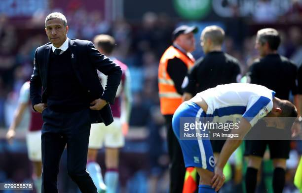 Brighton Hove Albion manager Chris Hughton and Brighton Hove Albion's Anthony Knockaert appear dejected after the final whistle during the Sky Bet...