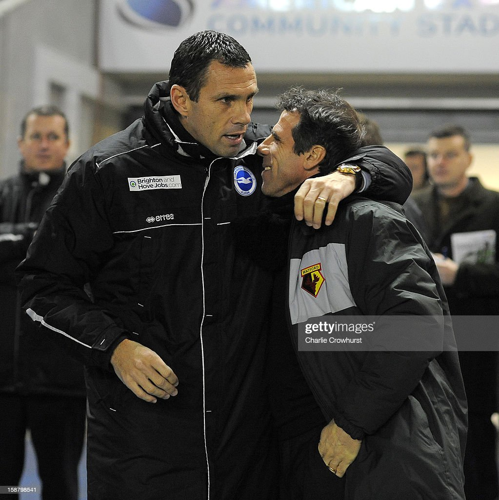 Brighton & Hove Albion manager Gus Poyet (L) greets Watford manager <a gi-track='captionPersonalityLinkClicked' href=/galleries/search?phrase=Gianfranco+Zola&family=editorial&specificpeople=213951 ng-click='$event.stopPropagation()'>Gianfranco Zola</a> prior to the npower Championship match between Brighton & Hove Albion and Watford at The Amex Stadium on December 29, 2012 in Brighton England.