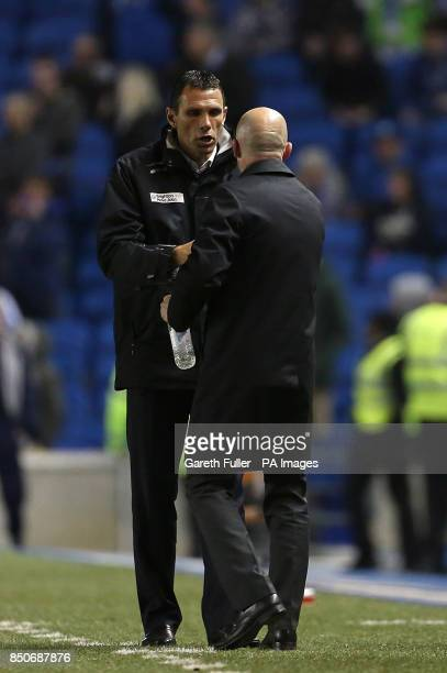 Brighton Hove Albion manager Gustavo Poyet shakes hands with Crystal Palace manager Ian Holloway after the final whistle