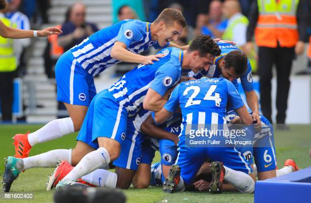 Brighton Hove Albion's Anthony Knockaert celebrates scoring his side's first goal of the game with team mates during the Premier League match at the...