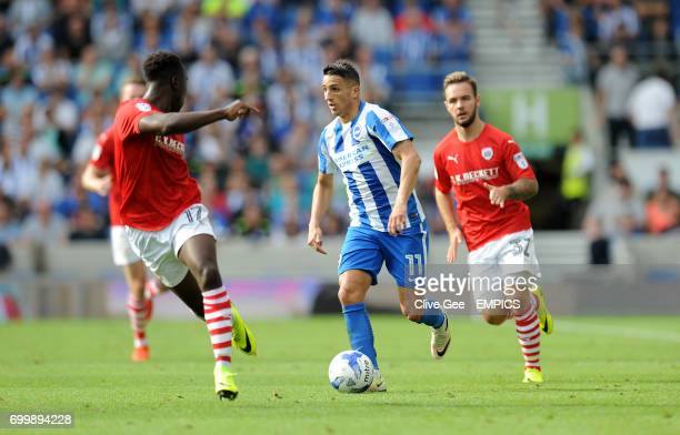 Brighton Hove Albion's Anthony Knockaert dribbles between Barnsley's Andy Yiadom and Adam Armstrong during the Sky Bet Championship match at the AMEX...