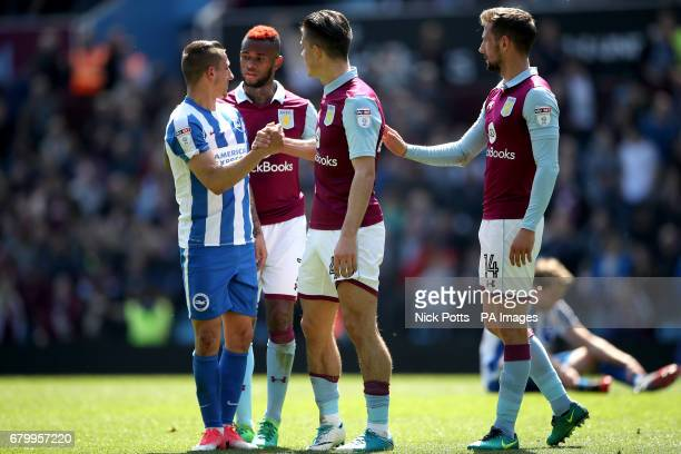 Brighton Hove Albion's Anthony Knockaert is consoled by Aston Villa's Leandro Bacuna Aston Villa's Jack Grealish and Aston Villa's Conor Hourihane...