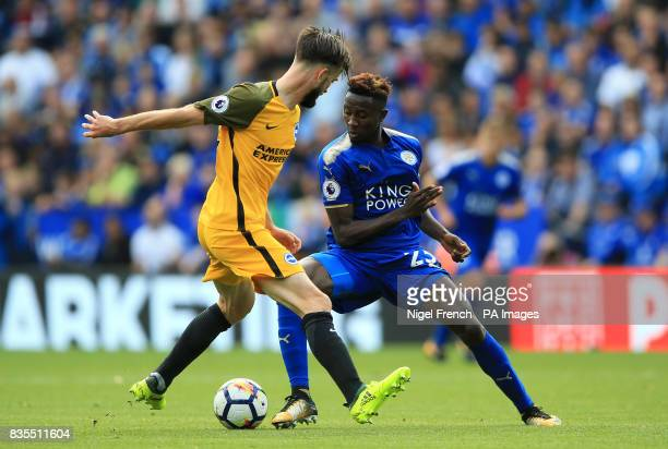 Brighton Hove Albion's Davy Propper and Leicester City's Wilfred Ndidi in action during the Premier League match at the King Power Stadium Leicester