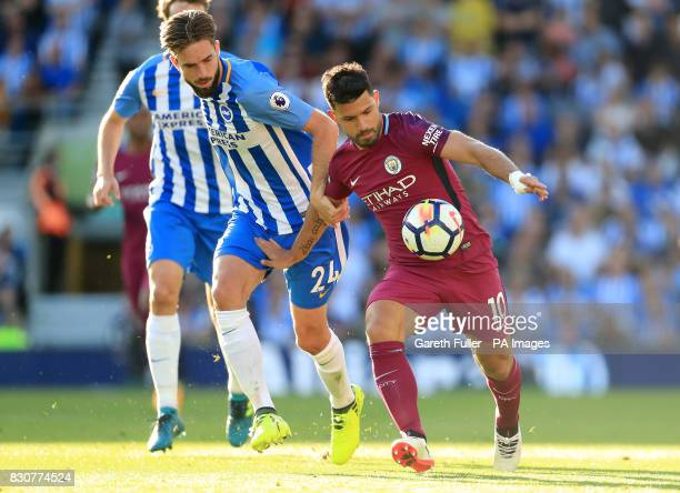 Brighton Hove Albion's Davy Propper and Manchester City's Sergio Aguero battle for the ball during the Premier League match at the AMEX Stadium...
