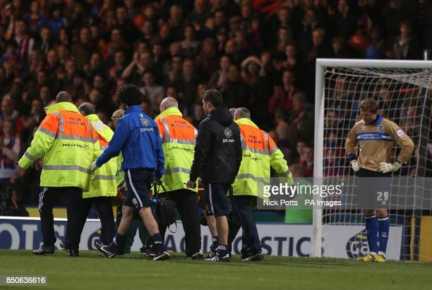 Brighton Hove Albion's goalkeeper Tomasz Kuszczak looks on as Crystal Palace's Glenn Murray leaves the pitch injured on a stretcher
