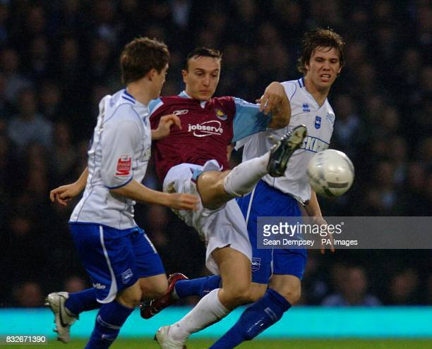 Brighton Hove Albion's Jake Robinson and Dean Hammond combine to tackle West Ham United Mark Noble