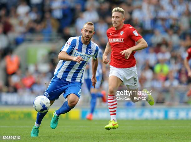 Brighton Hove Albion's Jiri Skalak and Barnsley's Angus MacDonald battle for the ball during the Sky Bet Championship match at the AMEX Stadium...