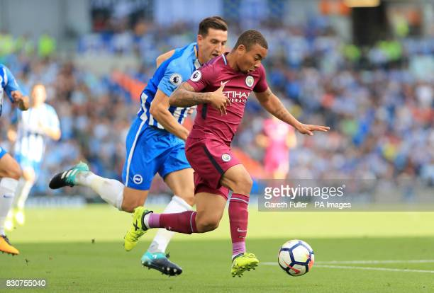 Brighton Hove Albion's Lewis Dunk and Manchester City's Gabriel Jesus battle for the ball during the Premier League match at the AMEX Stadium Brighton