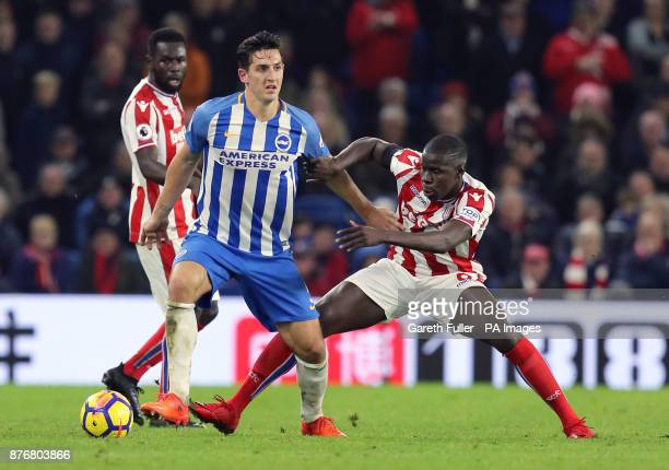 Brighton Hove Albion's Lewis Dunk and Stoke City's Kurt Zouma battle for the ball during the Premier League match at the AMEX Stadium Brighton