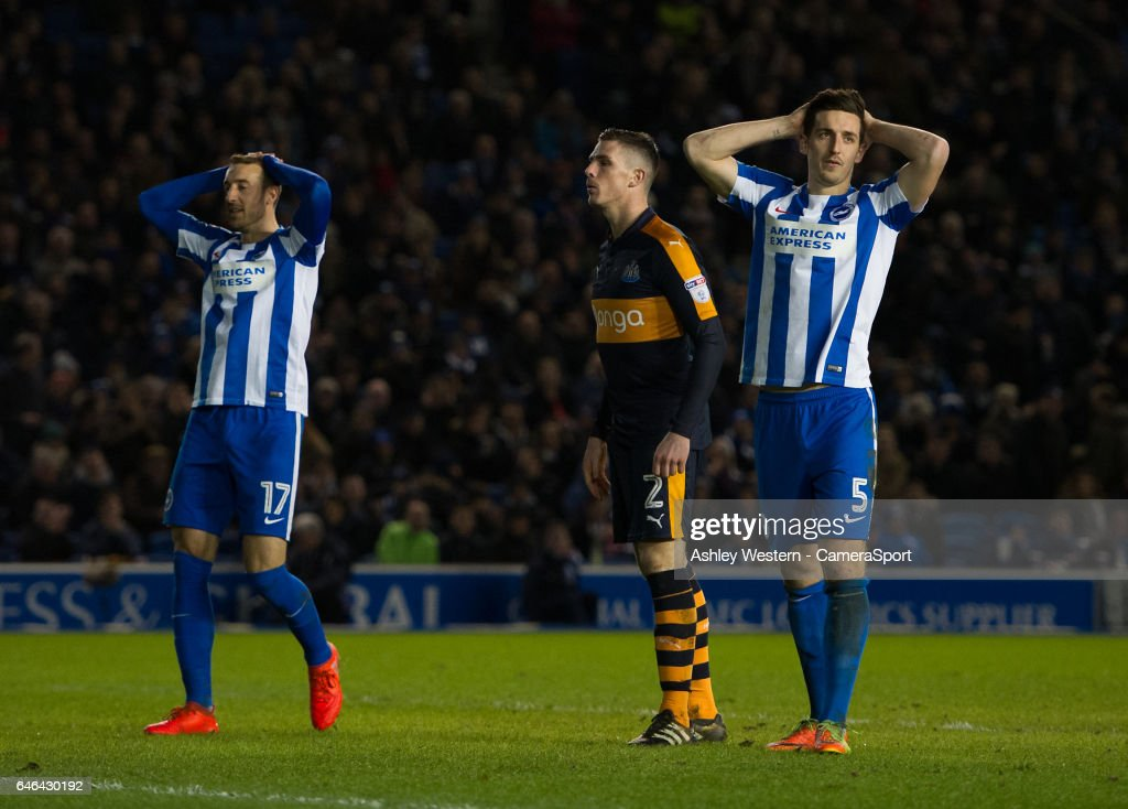 Brighton & Hove Albion's Lewis Dunk (right) frustrated as Paul Dummett clears off the line during the Sky Bet Championship match between Brighton & Hove Albion and Newcastle United at Amex Stadium on February 28, 2017 in Brighton, England.