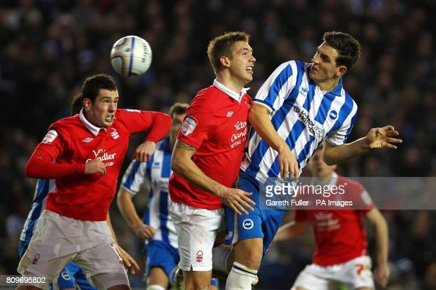 Brighton Hove Albion's Lewis Dunk heads towards goal challenged by Nottingham Forest's Luke Chambers and Greg Cunningham