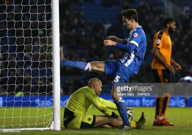 Brighton Hove Albion's Lewis Dunk kicks the post in frustration near the end of the game