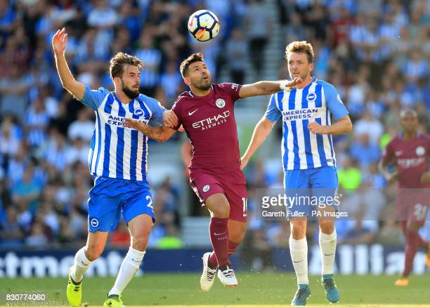 Brighton Hove Albion's Markus Suttner and Dale Stephens battle for the ball with Manchester City's Sergio Aguero during the Premier League match at...