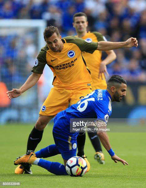 Brighton Hove Albion's Markus Suttner challenges Leicester City's Riyad Mahrez during the Premier League match at the King Power Stadium Leicester