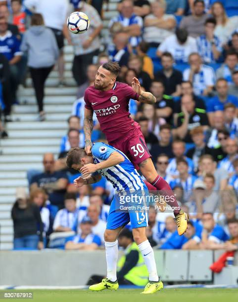 Brighton Hove Albion's Pascal Gross and Manchester City's Nicolas Otamendi battle for the ball during the Premier League match at the AMEX Stadium...