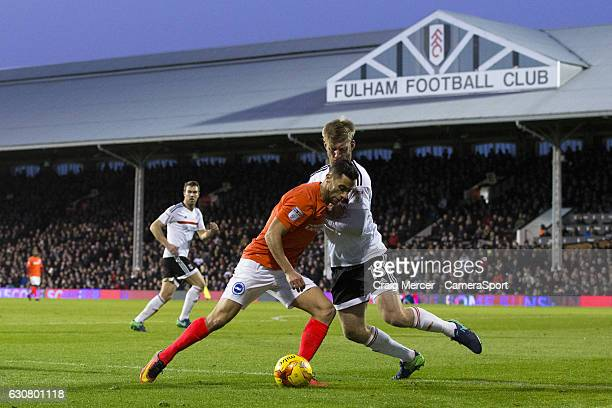 Brighton Hove Albion's Sam Baldock holds off the challenge from Fulham's Tim Ream during the Sky Bet Championship match between Fulham and Brighton...