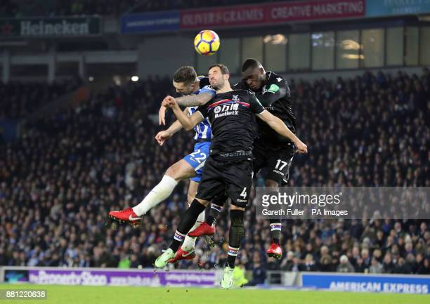 Brighton Hove Albion's Shane Duffy battles for the ball with Crystal Palace's Luka Milivojevic and Christian Benteke during the Premier League match...