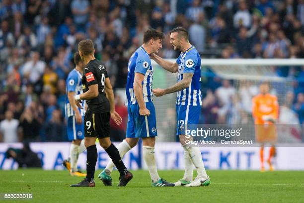 Brighton Hove Albion's Shane Duffy celebrates his sides victory at the final whistle with team mate Lewis Dunk during the Premier League match...