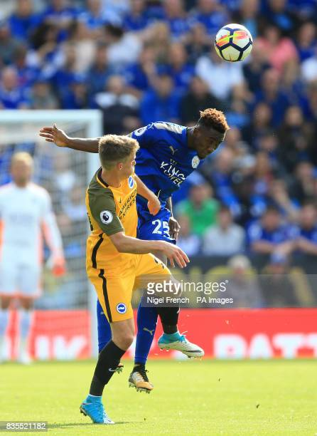 Brighton Hove Albion's Solly March and Leicester City's Wilfred Ndidi in action during the Premier League match at the King Power Stadium Leicester