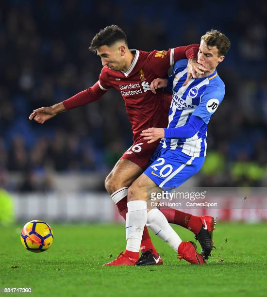 Brighton Hove Albion's Solly March battles with Liverpool's Marko Grujic during the Premier League match between Brighton and Hove Albion and...
