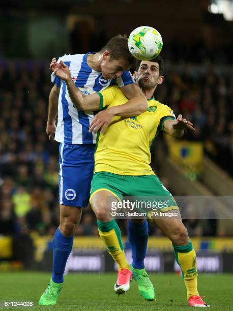 Brighton Hove Albion's Uwe Hunemeier and Norwich City's Nelson Oliveira battle for the ball during the Sky Bet Championship match at Carrow Road...