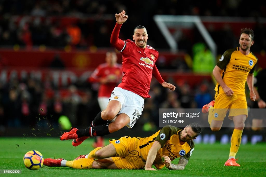 TOPSHOT - Brighton Irish defender Shane Duffy (L) challenges Manchester United's Swedish striker Zlatan Ibrahimovic (R) during the English Premier League football match between Manchester United and Brighton and Hove Albion at Old Trafford in Manchester, north west England, on November 25, 2017. / AFP PHOTO / Oli SCARFF / RESTRICTED TO EDITORIAL USE. No use with unauthorized audio, video, data, fixture lists, club/league logos or 'live' services. Online in-match use limited to 75 images, no video emulation. No use in betting, games or single club/league/player publications. /
