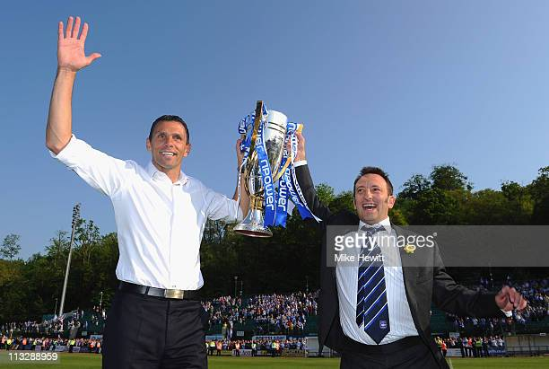 Brighton manager Gus Poyet and chairman Tony Bloom hold aloft the Division One trophy after the npower League One match between Brighton Hove Albion...
