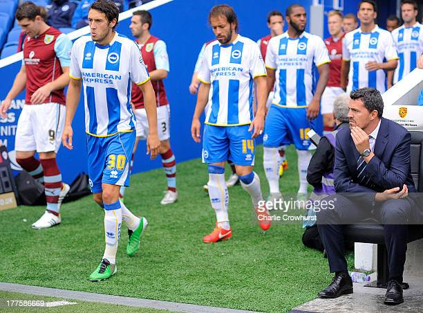 Brighton manager Oscar Garcia watches his Brighton team as they make their way onto the pitch during the Sky Bet Championship match between Brighton...