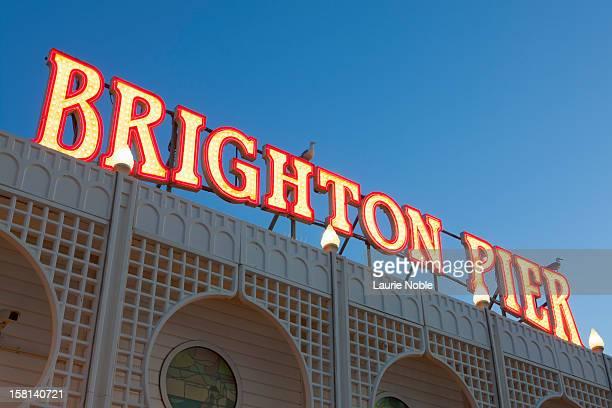 Brighton Pier sign illuminated, Brighton, Sussex