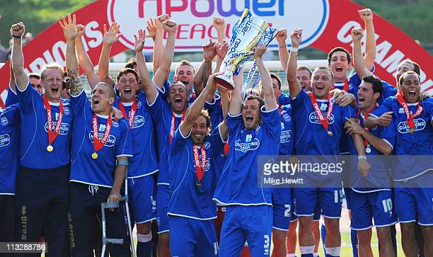 Brighton players celebrate as captain Gordon Greer of Brighton lifts the Division One trophy at the end of their last npower League One match between...