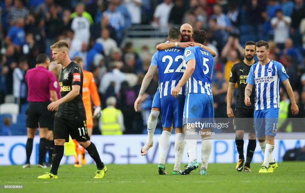 Brighton players celebrate victory as Matt Ritchie of Newcastle United (11) look dejected after the Premier League match between Brighton and Hove Albion and Newcastle United at Amex Stadium on September 24, 2017 in Brighton, England.
