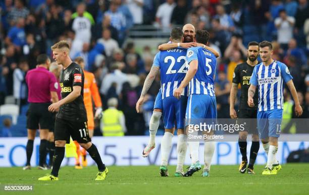Brighton players celebrate victory as Matt Ritchie of Newcastle United look dejected after the Premier League match between Brighton and Hove Albion...